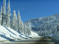Winter in mountains beautiful view on blue sky and road Stock Photography