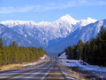 Winter mountains landscape road and forest Royalty Free Stock Photos