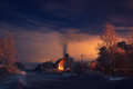 Winter night light house fire fog smoke Royalty Free Stock Photos