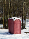 Winter Outhouse in the Woods Stock Photo