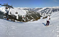Winter panorama with skiers Royalty Free Stock Photo