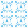 Winter pattern blue snowflakes and christmas trees Royalty Free Stock Images