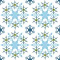 Winter pattern of blue snowflakes on white background. Decorative endless vector illustration