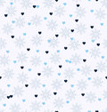 Winter pattern with hearts and snowflakes. Seamless vector backg