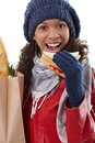 Winter portrait of afro woman with sandwich Royalty Free Stock Photography