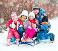 Winter portrait of happy young family Royalty Free Stock Photo