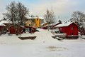 Winter porvoo sightseeing riverside storage buildings in old at cold day Royalty Free Stock Photo