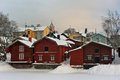 Winter porvoo sightseeing riverside storage buildings in old at cold day Royalty Free Stock Photos