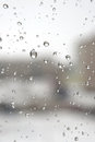 On a winter raining day drops of water the window shallow dof Royalty Free Stock Photo