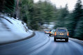 Winter road busy in evening on a mountain region Royalty Free Stock Photography