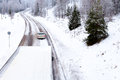 Winter road driving white car snow covered conditions Stock Photography