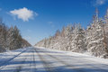 Winter road in snow fores Stock Photos