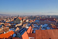 Winter rooftops in sibiu view over city romania during sunny evening colorful buildings and Stock Photography