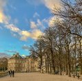 Bright blue sky, wispy clouds, over the Jardin du Luxembourg, Paris, France Royalty Free Stock Photo
