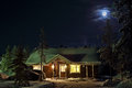 Winter s night wooden cottage in the evening finland Stock Photography