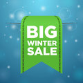 Winter sale big green ticket on blue background Royalty Free Stock Photography