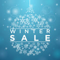 Winter sale in form of a ball of snowflakes blue background Stock Images