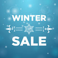 Winter sale and in the middle snowflake on blue background Royalty Free Stock Photography