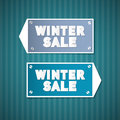 Winter sale retro signs on blue cardboard Royalty Free Stock Image