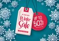 Winter sale tags vector banner. Sale tags hanging with falling snowflakes in blue background. Royalty Free Stock Photo