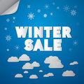 Winter sale title on abstract blue sky background with clouds and stars Royalty Free Stock Photography