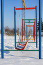 Winter scene with couple of swings in park sample Stock Photos