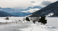 Winter scene italy a frozen lake in the resia reschen am see region of northern Stock Images