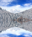 Winter scene in mountains with water reflection Royalty Free Stock Photo