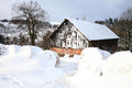 Winter scenery on the farm barn and bale of straw in snow Stock Photos