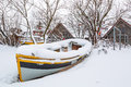 Winter scenery of fishing boats at baltic sea in poland Stock Photos