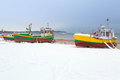 Winter scenery of fishing boats at baltic sea in poland Royalty Free Stock Photo