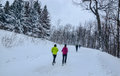 Winter Scenery with running people Royalty Free Stock Images