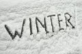 Winter scenery word write by hand on a frozen window car Royalty Free Stock Photography
