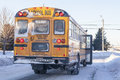 Winter school bus a typical yellow stopped to pick up passengers on an extreamly cold day Royalty Free Stock Image