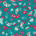 Winter seamless pattern with socks mittens and ha hats on the turquoise background Royalty Free Stock Image