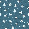 Winter seamless pattern. White snowflakes on blue background. Royalty Free Stock Photo