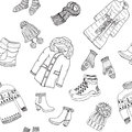 Winter season doodle clothes seamless pattern. Hand drawn sketch elements warm raindeer sweater, coat, boots, socks, gloves and ha