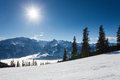 Winter with ski slopes of kaprun resort next to kitzsteinhorn peak in austrian alps Stock Photography