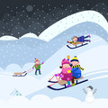 Winter sledding children fun on snow Stock Photography
