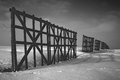 Winter, snow and fence. Black-and-white. Royalty Free Stock Photo