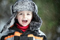 Winter snow fun three year old boy having in the outdoor cold and Royalty Free Stock Photos