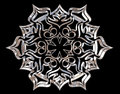 Winter snowflake on a black background