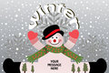 Winter snowman arms out sitting with snowflakes and gray sky Royalty Free Stock Images