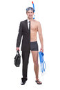 Winter sport concept young businessman with one foot already on vacation Royalty Free Stock Image