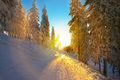 Winter sport track illuminated by the light of sunset on mountain Stock Photos