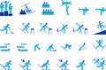 Winter sports icons a collection of blue and competition including skiing figure skating hockey downhill racing ski jumping Royalty Free Stock Photo