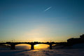 Winter sunrise bridge trace of the plane Royalty Free Stock Photography