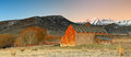 Winter sunrise panorama with an old barn. Royalty Free Stock Photo