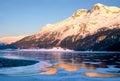 Winter sunset in engadin switzerland reflects on frozen lakes of Stock Photos