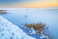 Winter sunset over frozen pond Royalty Free Stock Photo